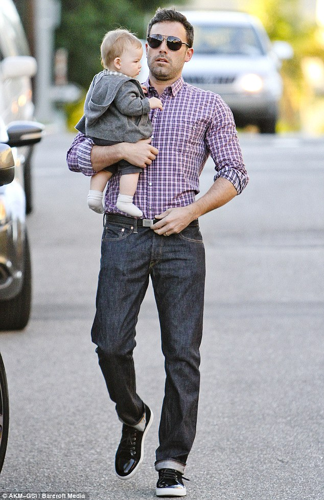 Daddy day care: Hands on father Ben carried little baby Samuel into a restaurant on Sunday for a family meal