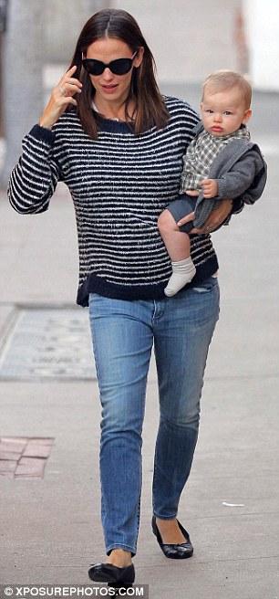 Happy little man: Jennifer looked low key in a striped sweater and jeans as she carried little Samuel