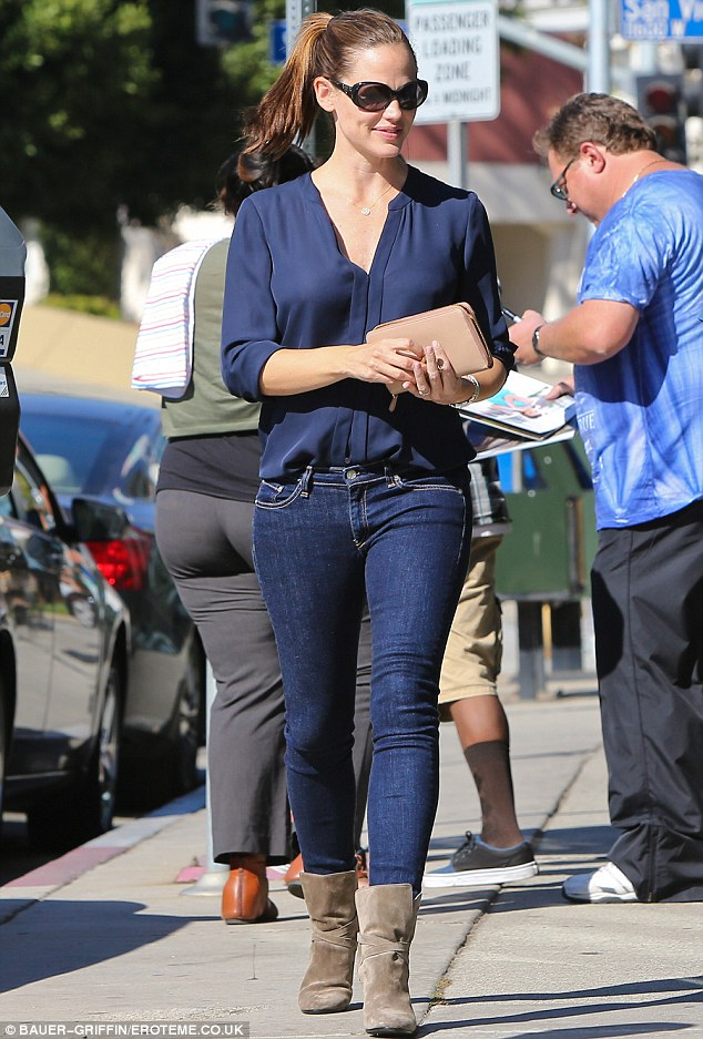 Looking good: Jennifer displayed her trim figure in the skinny leg jeans and a silky blouse as she headed out for lunch in Brentwood on Monday