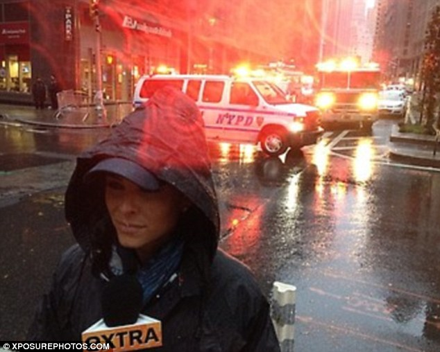 Downpour: Meanwhile, TV host Maria Menounos also braved the rain in the Big Apple to report for Extra!