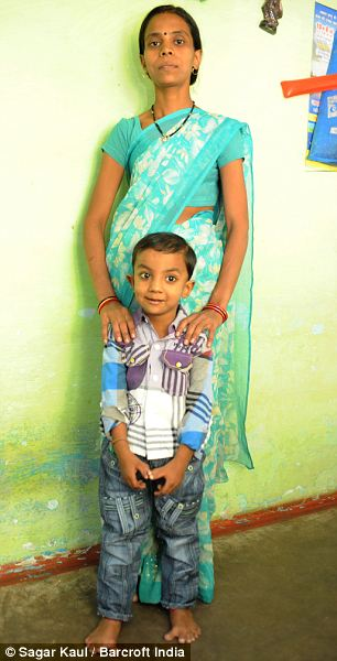 Arpan Saxena (4), poses for a photograph with his mother Taruna Saxena (30) in Bhopal