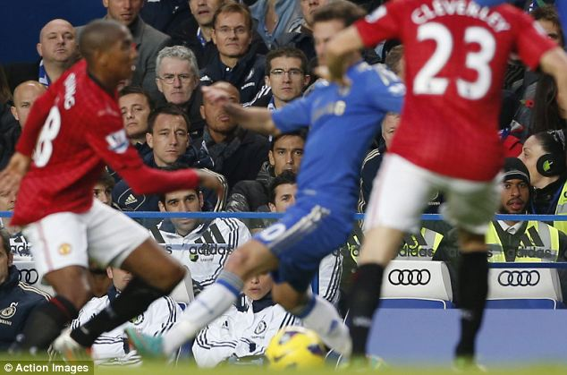 John Terry watches from the stands as Ashley Young takes on Juan Mata