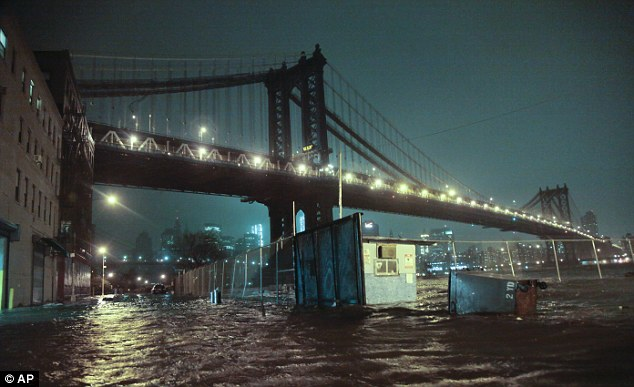 Streets are flooded under the Manhattan Bridge