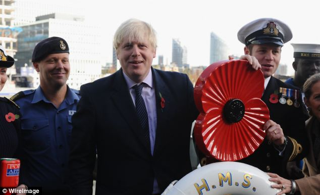 Having safely climbed aboard, Mr Johnson posed for photos with crew from HMS Severn