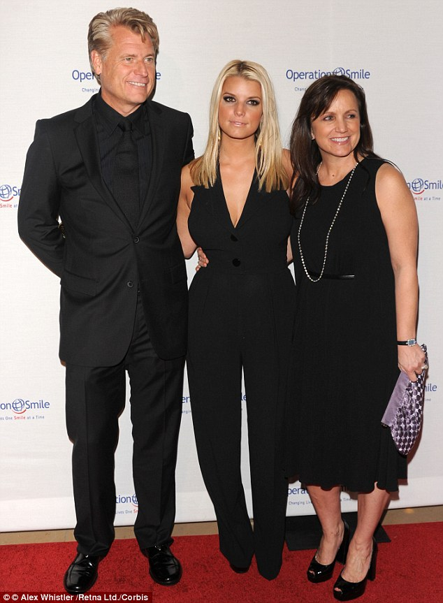 Torn apart: Joe with his eldest daughter Jessica and wife Tina in 2009