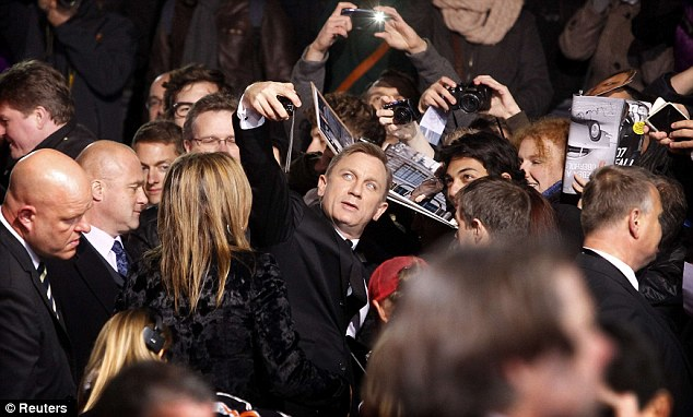The name's Bond: The British actor seemed to be enjoying himself as he met with German fans