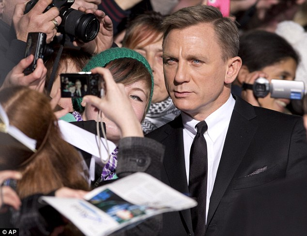Crowd-pleaser: Daniel Craig delighted fans as he posed for photographs and signed autographs