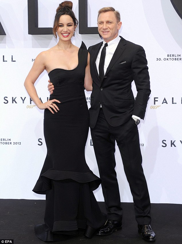 Licence to thrill: Berenice and her leading man Daniel Craig opted for complementing monochrome ensembles as they posed together on the red carpet