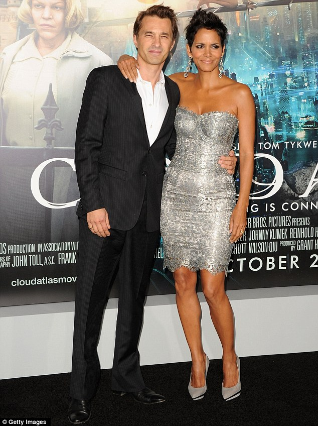 Ready to move to France: Berry posed with her fiancé of two years Olivier Martinez at the Hollywood premiere for Cloud Atlas last week
