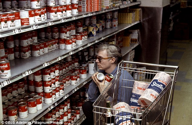 Inspiration: Andy Warhol buys some of the soup cans he made famous at the Gristedes supermarket in New York City in 1965.