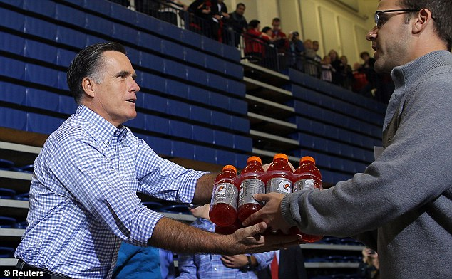 U.S. Republican presidential nominee Mitt Romney accepts relief supplies for people affected by Hurricane Sandy