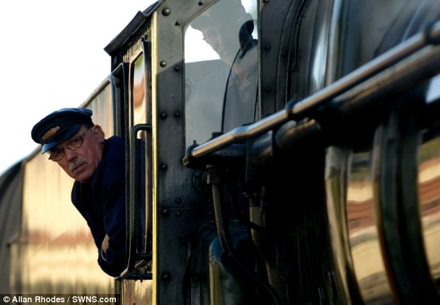A steam train driver prepares to depart on the GWR for the first time since £1million repairs were carried out following a campaign to raise funds