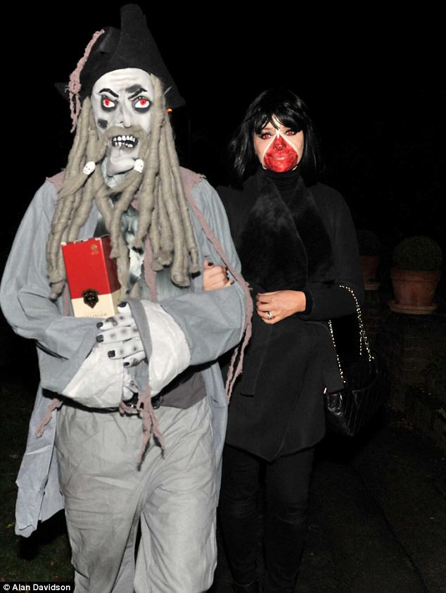 Spooky pair: Holly was accompanied by a man, presumably her husband, who was dressed like Jack Sparrow