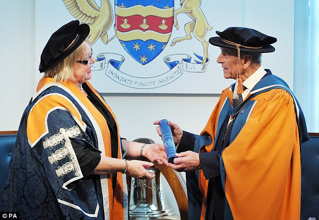 The Duke of Edinburgh is presented with an honorary doctorate of marine science from Plymouth University by Vice Chancellor Wendy Purcell