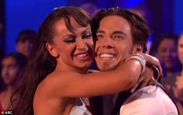 Overjoyed: Apolo and Karina share an ecstatic hug after learning they are going through to next week's show