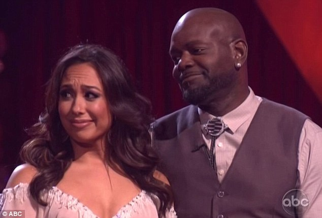 Emotional: Emmett Smith and Cheryl Burke wait to see if they have been safely put through to next the round