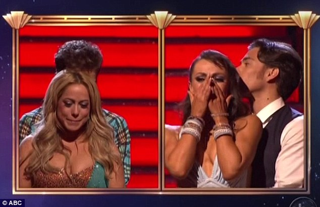 Tense: The other couple with the bottom overall scores was Apolo Ohno and partner Karina Smirnoff. All four look nervous just minutes before the results are read out