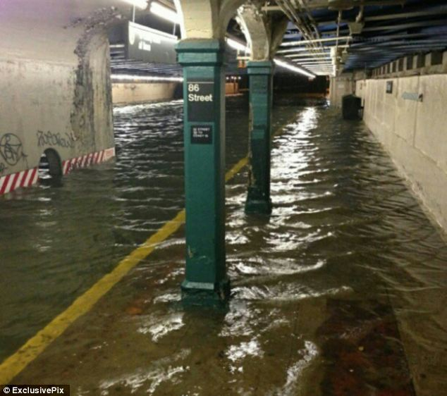 Historic shut down: As flood waters inundated many stations including 86th Street, Mayor Michael Bloomberg announced that subway service would be shut down until Saturday or Sunday, only the second time it has ever closed