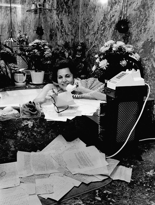 In demand: Advice columnist Ann Landers takes a call while she bathes in 1974