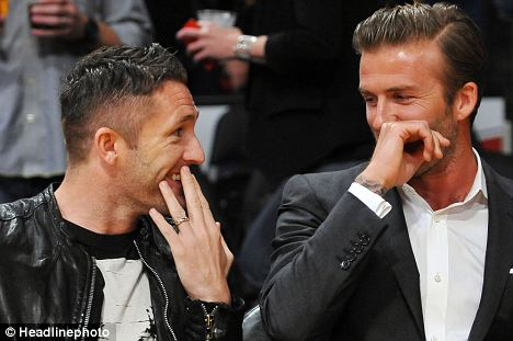 Having a ball: Beckham and LA Galaxy team-mate Robbie Keane drop in to watch the LA Lakers against the Dallas Mavericks in the NBA