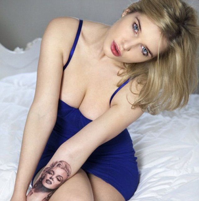 For all eyes... In the final shot, wearing a cobalt blue dress, Helen shows of her tattoo