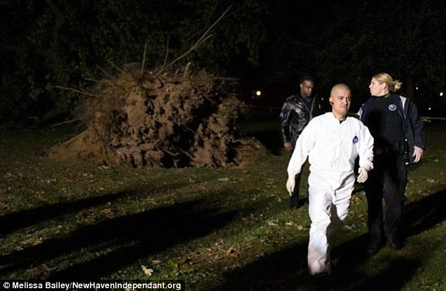 Exhumation: Removing the body took nearly seven hours in total