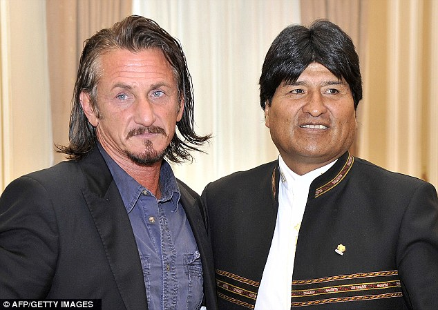 US actor Sean Penn, left, and Bolivian President Evo Morales, right, during a meeting at the Quemado presidential palace in La Paz yesterday