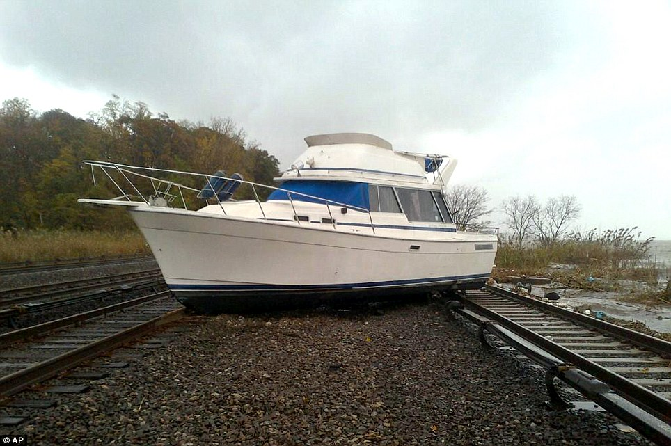 On the rails: This photograph, provided by the state of New York's Metropolitan Transportation Authority, shows a boat resting on the tracks at Metro-North's Ossining Station in the aftermath of Superstorm Sandy