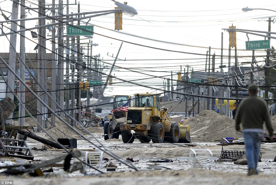 Chaotic: Streets in Seaside Heights, New Jersey, are covered with fallen power lines and debris following heavy damage by Superstorm Sandy
