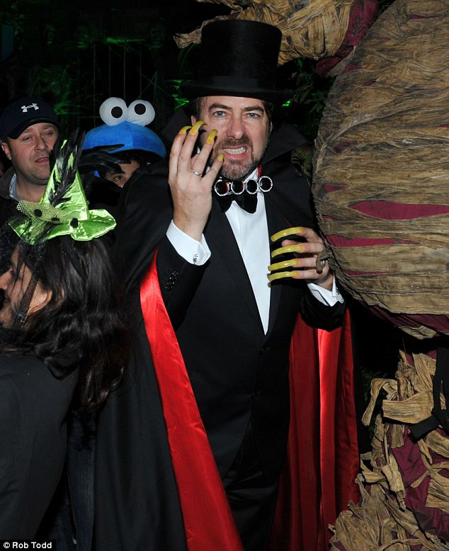 Host: Jonathan Ross appeared to be dressed at Count Dracula for his party