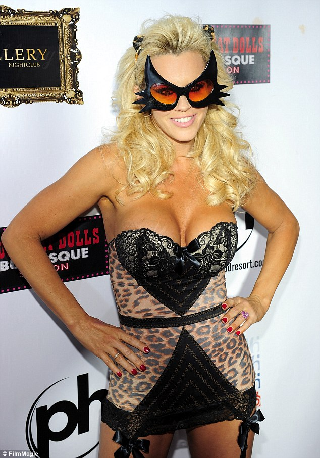 Bearing it all: Jenny McCarthy celebrates Halloween and her birthday by wearing nothing more than lingerie