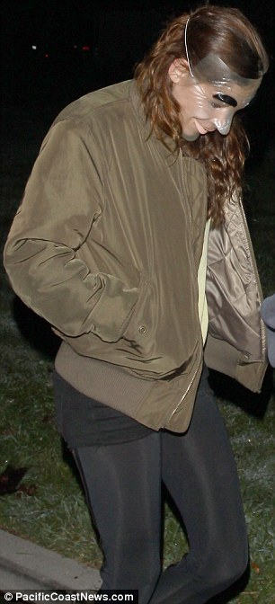 Regular look: Stewart wore leggings and a green jacket while Pattinson was clad in jeans, T-shirt and a cap