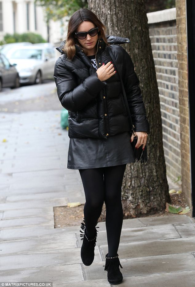 Keeping cosy: Kelly gave nothing away as she left her home ahead of her burlesque debut