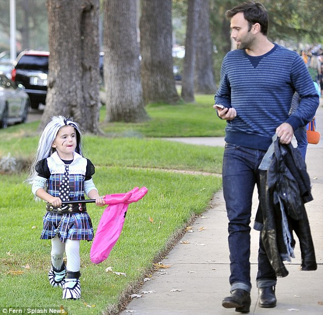 Father and daughter time: The pair were having a ball as they made their way around the streets