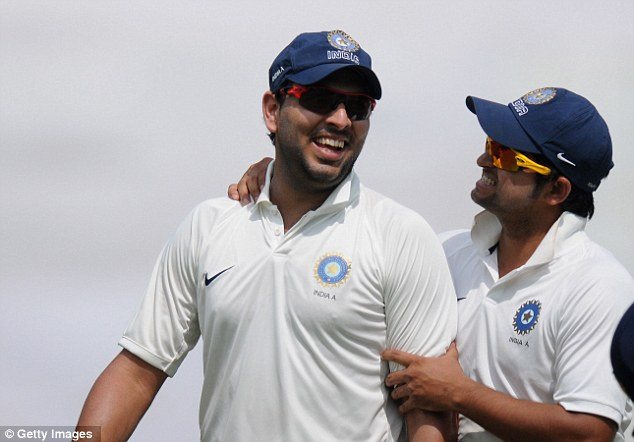 Warning signs: Part-time left-arm spinner Yuvraj Singh (right) picked up five England wickets