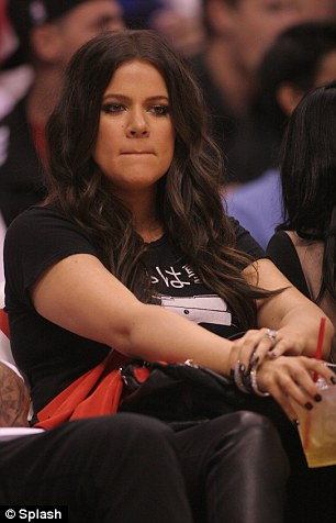 No hard feelings: Khloe had promised to make it to the game and stuck to her word