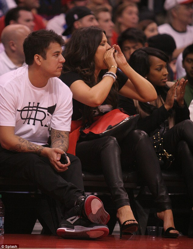 Sing when you're winning: Khloe was very animated during the game and shouted encouragement at her husband