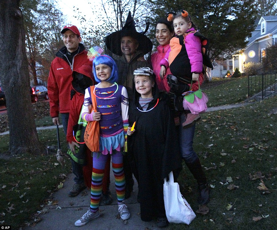 Trick or treat: Republican vice presidential candidate Paul Ryan (left) joins his family on a Halloween outing