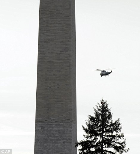 Onwards and upwards: The Marine One helicopter flies past the Washington Monument