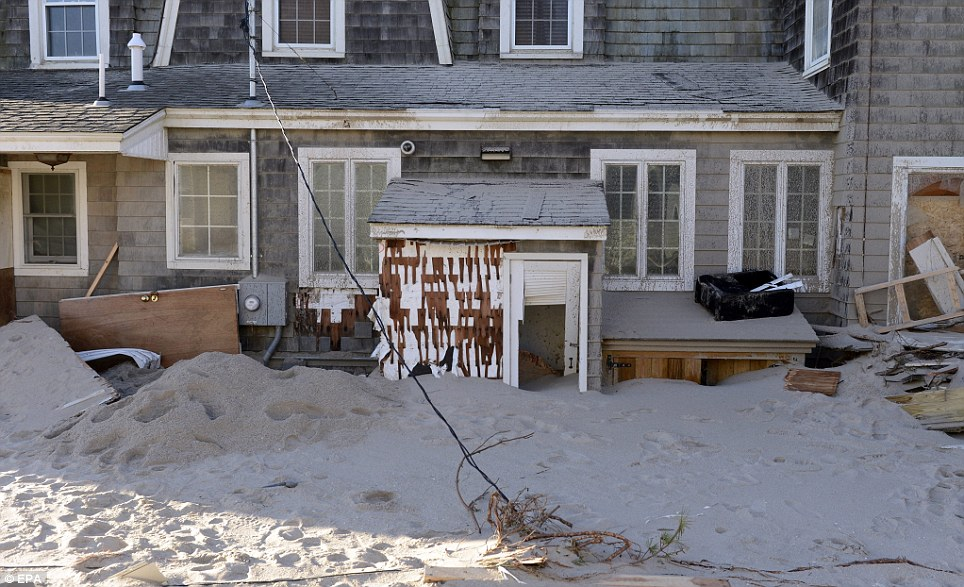 Lethal: A power line hangs down from a storm-damaged house in Bay Head, New Jersey, following the storm
