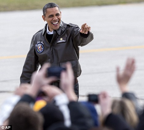 Good to see you: Mr Obama will make a quick stop in Wisconsin before heading to Las Vegas
