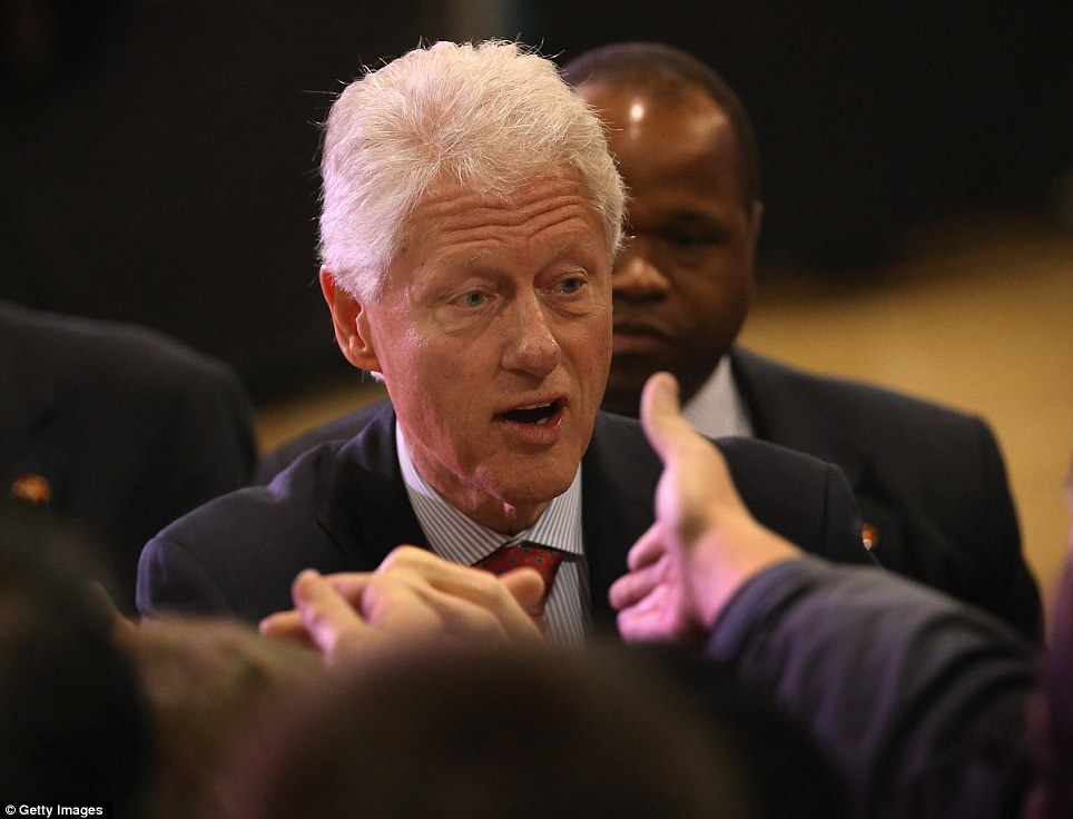 Big hitter: Former President Bill Clinton campaigns for President Barack Obama during a rally at the University of Wisconsin-Waukesha on Thursday. Clinton is also expected to campaign for Obama in Florida and Virginia