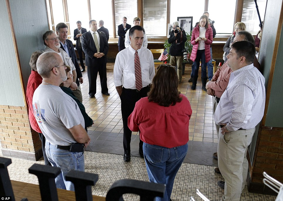 Food for thought: Republican presidential candidate Mitt Romney stands with his hands in his pockets as he hears from Bill's Barbecue owner Rhoda Elliott (in red, back to camera)