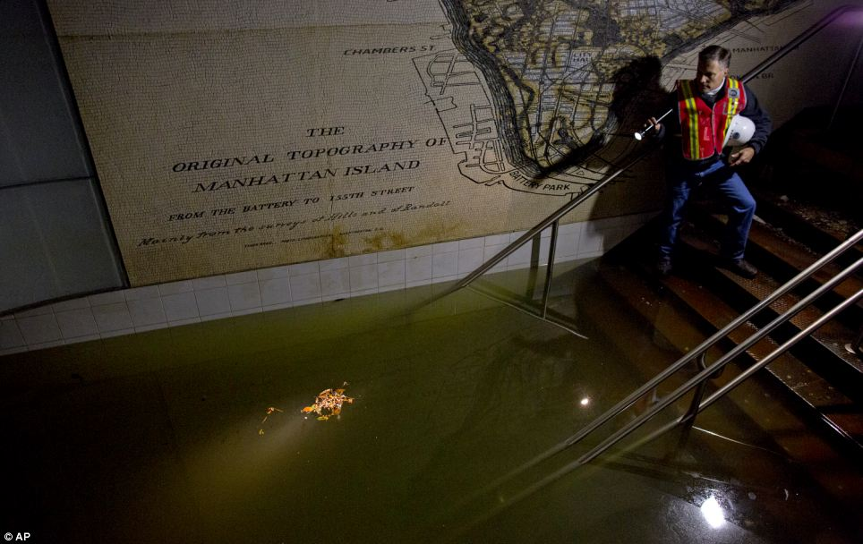 In the dark: Joseph Leader, Metropolitan Tranportation Authority Vice President and Chief Maintenance Officer, shines a flashlight on standing water inside the South Ferry 1 train station