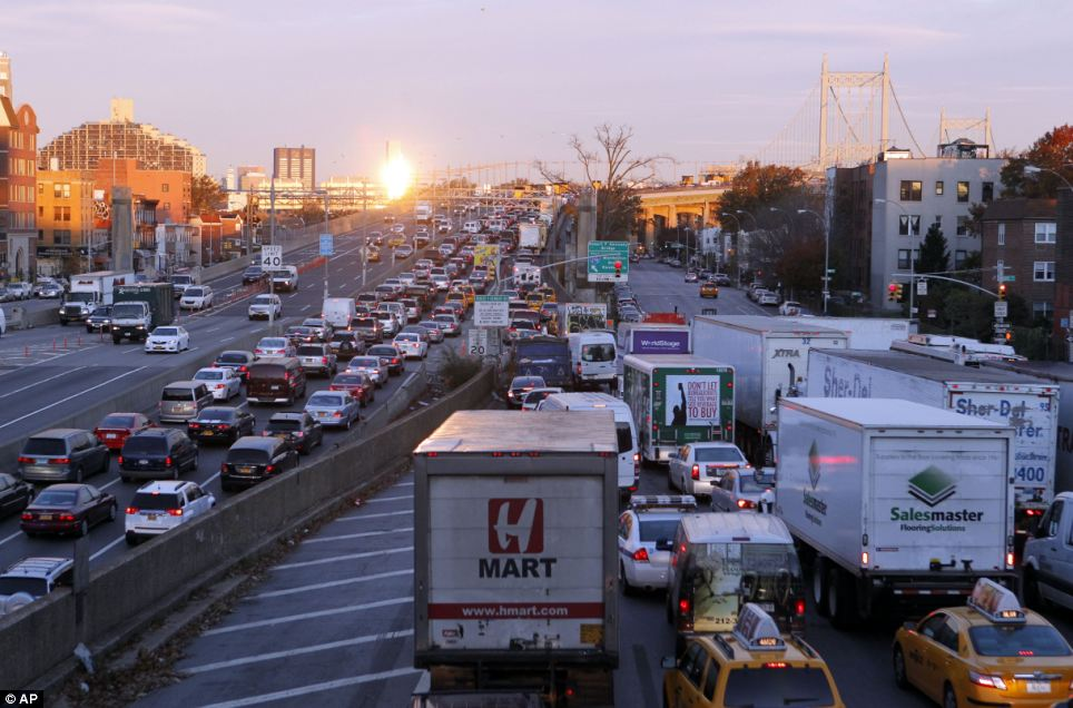 Long wait: Heavy traffic crawling over Robert F. Kennedy Triboro Bridge in Queens today, as the city's transport system continues to struggle