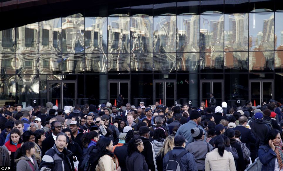Where does the line start? Commuters wait to board buses into Manhattan in front of the Barclays Center in Brooklyn, New York