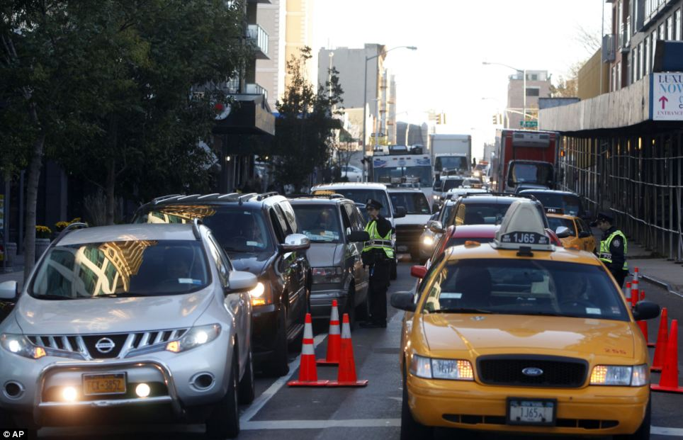 Recovery: Cars and taxis inched through crowded streets without working stoplights today