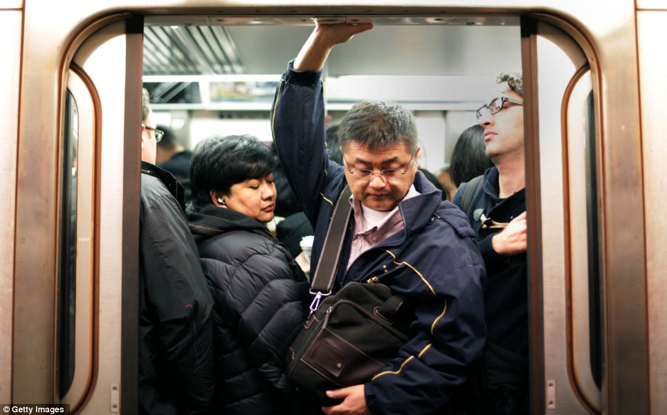 Squashed: People flooded the subways this morning after they reopened following five days of closure