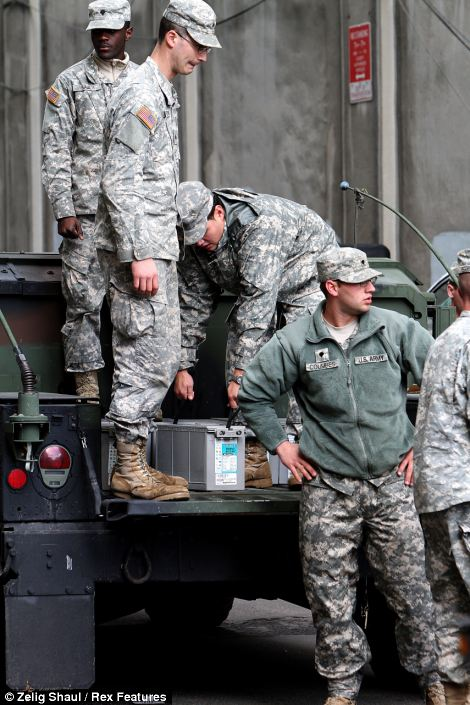 National Guard Soldiers with the 204th Engineers Battalion and other units arrive in downtown Brooklyn