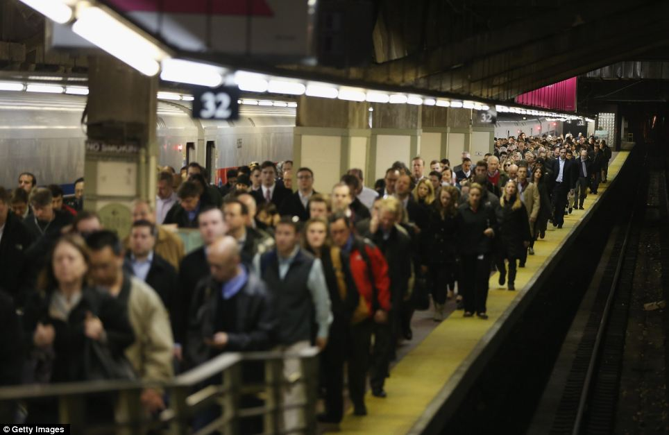 Nightmare journeys: Passengers leave a Metro-North train arriving in Grand Central Terminal during the morning rush today